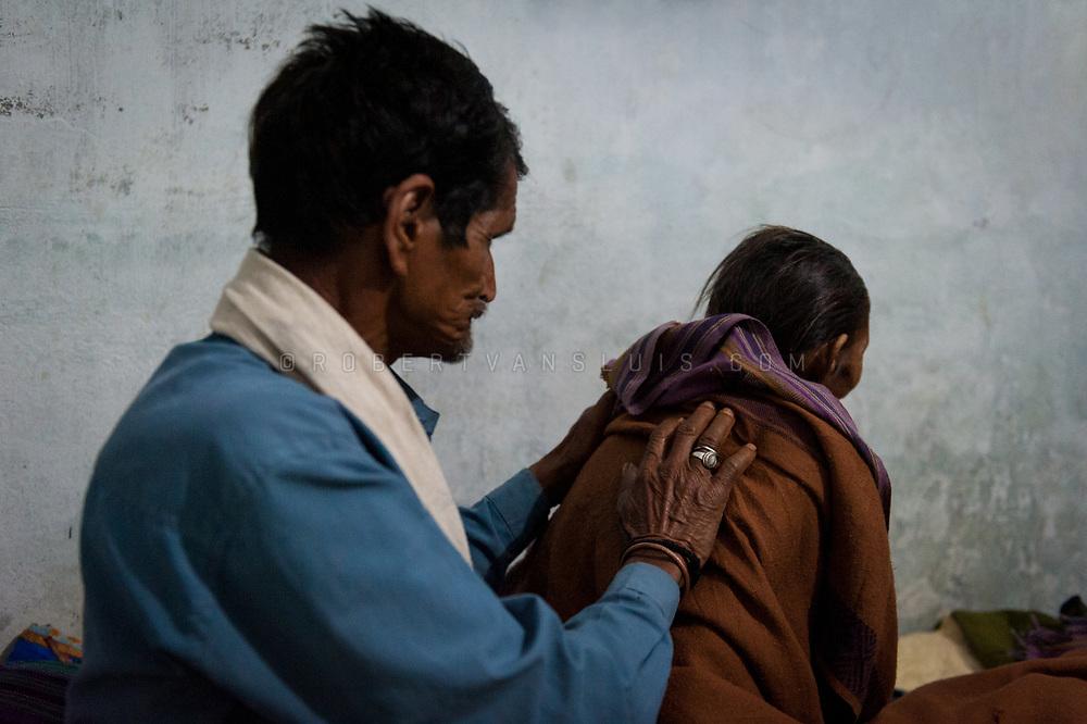 Portrait of an elderly lady and her son at the Kashi Labh Mukti Bhawan hospice, Varanasi, India. Photo © robertvansluis.com