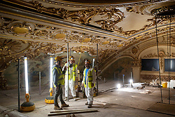 IMAGES SHOT ON APRIL 20TH 2021 © Licensed to London News Pictures. 12/05/2021. Blackpool, UK. Project Manager Keith Langton (L) and fibrous plasterwork conservator Phil Barlow (R) inspect the major conservation project taking place in the Tower Ballroom, in Blackpool, Lancashire on April 20, 2021. The Blackpool Tower Ballroom, located in the Grade 1 Listed Tower and which dates back to 1894, has undergone the most extensive programme of work and deep clean for more than 60 years totaling £1.1M. A team of skilled, specialist craftsmen, who have worked across the world on projects including the Queen's Gallery at Buckingham Palace, have dedicated more than 21,000 hours, over a period of six months, to restore the famous Ballroom to its original glory. Due to the Coronavirus pandemic the ballroom has now been closed for over 12 months and is scheduled to re-open to the public on June 21, 2021. Photo credit: Oli Scarff/LNP