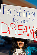 """07 DECEMBER 2010 - PHOENIX, AZ:  VANIA GUEVARA pickets the front of US Sen. John McCain's offices in Phoenix Tuesday on support of the DREAM Act. Dolores Huerta, who started working in the civil rights movement in the 1960's, threw her support behind students fasting on behalf of the DREAM Act in front of Sen. John McCain's office Tuesday. The student picked McCain's office because he used to support the DREAM Act. They hope that the US Senate will pass the DREAM Act during its """"lame duck"""" session. The Senate debated and defeated similar legislation just before the November general election.    PHOTO BY JACK KURTZ"""