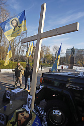 November 18, 2018 - Kie, Ukraine - The opponents against a transgender rally stand next to the cross,during their a protest in downtown of Kiev, Ukraine, 18 November 2018. Two participants of rally for support of transgender rights were attacked with pepper-spray as the transgender rights march was interrupted by dozens of far rights activists. Few tens transgender people were trying to organized the march for support transgender rights and to honor the memory of those who died because of transphobia, hate and the prejudices and to mark International Day of Transgender People. (Credit Image: © Str/NurPhoto via ZUMA Press)