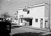 0001-C16 Beaverton Oregon. Ritz Theater (next to Beaverton Bakery, 12375 SW Broadway, Beaverton.) 1941. Man Hunt movie poster on theater.