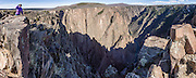 Pulpit Rock Overlook, Black Canyon of the Gunnison National Park, near Montrose, Colorado, USA. The canyon exposes you to some of the steepest cliffs, oldest rock, and craggiest spires in North America. With two million years to work, the Gunnison River, along with the forces of weathering, has sculpted this vertical wilderness of rock, water, and sky. This panorama was stitched from 12 overlapping photos.