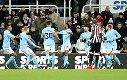 Manchester City's Raheem Sterling (centre) celebrates scoring his side's first goal of the game with team mates during the Premier League match at St James' Park, Newcastle.