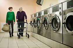 Man and woman are talking in laundry