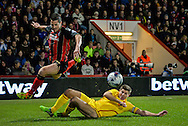 Yann Kermorgant and Steven Gerrard during the Capital One Cup match between Bournemouth and Liverpool at the Goldsands Stadium, Bournemouth, England on 17 December 2014.