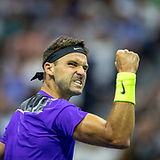 2019 US Open Tennis Tournament- Day Nine.  Grigor Dimitrov of Bulgaria celebrates a break in the second set against Roger Federer of Switzerland in the Men's Singles Quarter-Finals match on Arthur Ashe Stadium during the 2019 US Open Tennis Tournament at the USTA Billie Jean King National Tennis Center on September 3rd, 2019 in Flushing, Queens, New York City.  (Photo by Tim Clayton/Corbis via Getty Images)