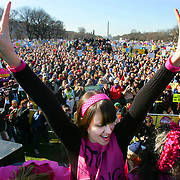 WASHINGTON, DC - JANUARY 27: Dana Balicki, of New York, flashes peace signs as she leaves the stage as part of Code Pink for Peace's statement on the Iraq War during an anti-war rally and march on the National Mall on Saturday, Jan. 27, 2007 in Washington.  Thousands of protesters descended on Washington to protest the Iraq War and call for Congress to take action against it.