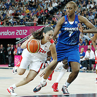 11 August 2012: USA Sue Bird drives past Sandrine Gruda during 86-50 Team USA victory over Team France, during the Women's Gold Medal Game, at the North Greenwich Arena, in London, Great Britain.