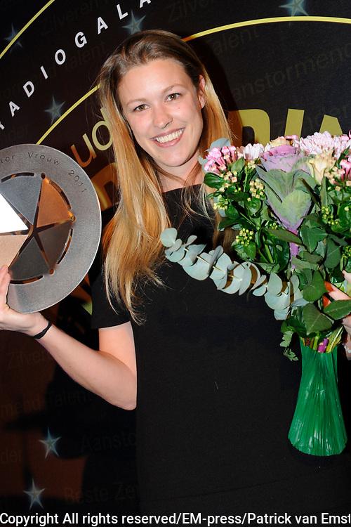 AVRO Radiogala 2011 in het Stadhuis van Hilversum.<br /> <br /> Op de foto:  Annemieke Schollaerd heeft de AVRO Zilveren Radioster 2011 bij de vrouwen gewonnen.