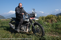 Kiwi Mike Tomas poses with a spectacular background of 23,000' peaks on day-4 our our Himalayan Heroes adventure riding from Pokhara to Kalopani, Nepal. Friday, November 9, 2018. Photography ©2018 Michael Lichter.