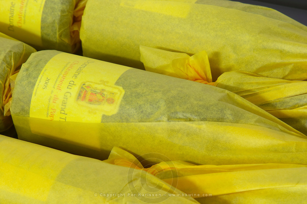 bottles wrapped in paper domaine du grand tinel chateauneuf du pape rhone france