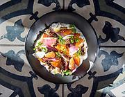 Photo by Mara Lavitt<br /> January 22, 2019<br /> New Haven, CT<br /> <br /> Olmo restaurant (also Olmo Kitchen). Beet salad: stracciatella, preserved Maine blueberries, apple vinegar, dukkah.