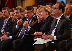 French Economy Minister Emmanuel Macron, Vice-chancellor Sigmar Gabriel, Chancellor Angela Merkel and French President Francois Hollande attend a joint statement after the France-Germany digital conference at the Elysee palace on October 27, 2015 in Paris, France. Francois Hollande, Angela Merkel and Jean-Claude Juncker attend a workshop on new technologies during a 1st Franco-German Digital Conference at the Elysee Palace. Photo by Christian Liewig/ABACAPRESS.COM