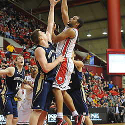 Rutgers Scarlet Knights forward/center Austin Johnson (21) hooks in a basket over Notre Dame Fighting Irish forward Jack Cooley (45) during Big East NCAA action during Rutgers' 65-58 victory over Notre Dame at the Louis Brown Athletic Center in Piscataway, N.J.