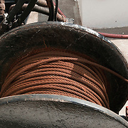 Spool of cable on a fishing trawler in Gloucester, MA harbor.