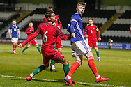 Connor Smith (C)(Heart of Midlothian) looses out to Jo?o Daniel during the U17 European Championships match between Portugal and Scotland at Simple Digital Arena, Paisley, Scotland on 20 March 2019.