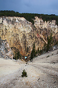 The Grand Canyon of Yellowstone, in Yellowstone National Park, Wyoming. The reason for the colours of the rhyolite rocks is that they are oxidising, or rusting due to their iron content.