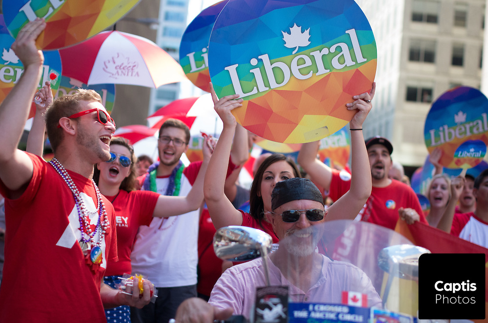 Supporters of the Liberal party of Canada march during the parade. August 24, 2014.