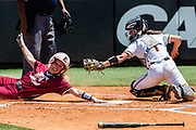 Elon junior second baseman Morgan Reich seems to beat Towson catcher Riley Thies as she slides into home plate, but is called out at Hunt Softball Park on April 28, 2019.