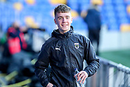 AFC Wimbledon defender Jack Currie (26) walking at side of pitch during the EFL Sky Bet League 1 match between AFC Wimbledon and Hull City at Plough Lane, London, United Kingdom on 27 February 2021.