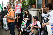 London, UK. Saturday 19th July 2014. Pro-Palestinian protesters in their tens of thousands march through central London to the Israeli Embassy in protest against the military offensive in Gaza by Israel. Family exhausted due to Ramadan fasting.