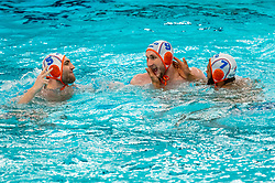 Jorn Muller, Guus van IJperen, Bilal Gbadamassi of the Netherlands in action against France during the Olympic qualifying tournament. The Dutch water polo players are on the hunt for a starting ticket for the Olympic Games on February 17, 2021 in Rotterdam