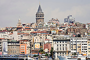 08 AUGUST 2007 -- ISTANBUL, TURKEY: The Galata Tower and skyline of Istanbul, Turkey. Istanbul, a city of about 14 million people, and the largest city in Turkey, straddles the Bosphorus Straits between Europe and Asia. It is one of the oldest cities in the world. It was once the center of the Eastern Roman Empire and was called Constantinople, named after the Roman Emperor Constantine. In 1453, Mehmet the Conqueror, Sultan of the Ottoman Empire, captured the city and made it the center of the Ottoman Turkish Empire until World War I. After the war, the Ottoman Empire was dissolved and modern Turkey created. The capitol was moved to Ankara but Istanbul (formerly Constantinople) has remained the largest, most diverse city in Turkey.    Photo by Jack Kurtz