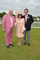 Left to right, CHRISTOPHER BIGGINS, DAME JOAN COLLINS and PERCY GIBSON at the Cartier Queen's Cup Polo final at Guard's Polo Club, Smiths Lawn, Windsor Great Park, Egham, Surrey on 14th June 2015