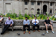 As heatwave temperatures climb to record levels - the hottest day of the year so far - Londoners in the City of London the capitals financial district aka the Square Mile rest on benches opposite the Bank of England on Threadneedle Street, on 25th July 2019, in London, England.