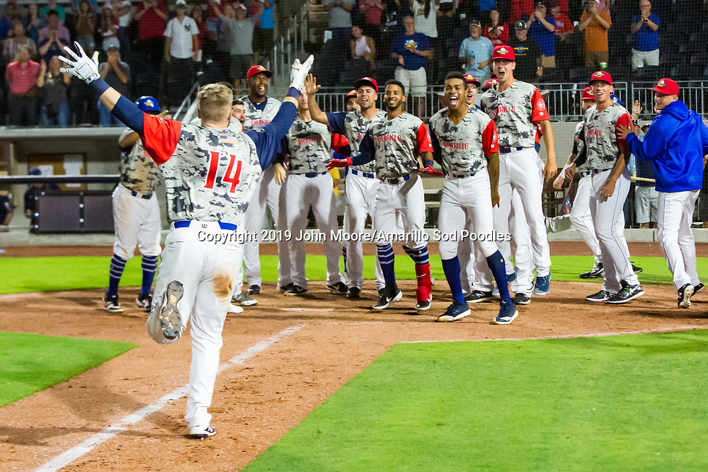 Amarillo Sod Poodles infielder Owen Miller (14) rounds the bases after hitting a walkoff home run against the Northwest Arkansas Travelers on Monday, July 22, 2019, at HODGETOWN in Amarillo, Texas. [Photo by John Moore/Amarillo Sod Poodles]