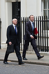 © London News Pictures. 19/05/15. London, UK. Iain Duncan Smith, Works and Pensions Secretary and Matt Hancock, Minister of State for Effenciency and Civil Service Reform, attend the cabinet meeting, Downing Street, Central London. Photo credit: Laura Lean/LNP