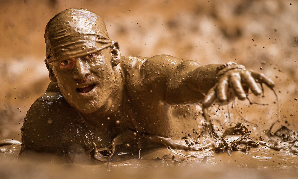 Over 10000 people participated in the Warrior Dash ultimate race involving 10 insane obstacles that included jumping over fire and belly crawling in the mud under barbed wire in North Plains, OR Saturday and Sunday. The race/festival included live music, food and beer.