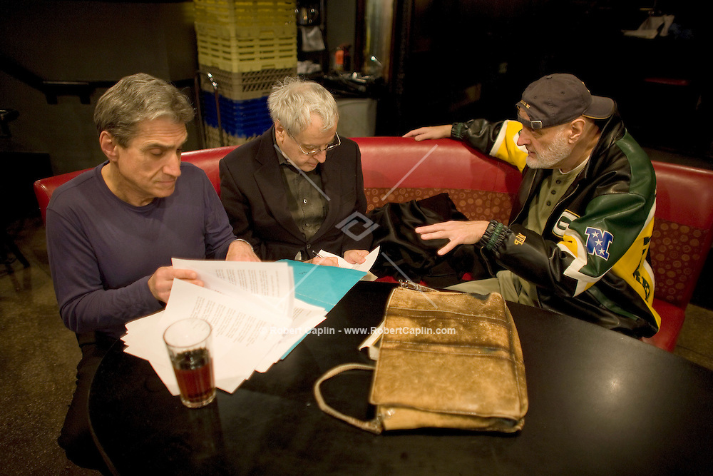 Promoter Milan Simich, right, and brother of current US poet laureate Charles Simic, middle, (last names spelled differently) prior to a poetry reading during to a collaboration with jazz musicians and former laureate, Robert Pinsky, left, at the Jazz Standard in New York, U.S. 1/8/08.