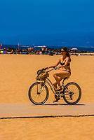 People riding bikes along the Ocean Front Walk at Venice Beach, Los Angeles, California USA.
