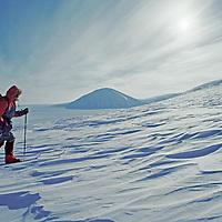 An expedition skier climbs above Lomonosov Icecap, Spitsbergen Island, Norway.