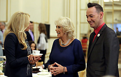 Embargoed to 0001 Saturday December 23 The Duchess of Cornwall, President of the National Osteoporosis Society, talks to 'Strictly Come Dancing' host Tess Daly (left) accompanied by judge Craig Revel Horwood as she hosts a tea dance at Buckingham Palace in London attended by 'Strictly Come Dancing' dancers and judges to highlight the benefits for older people of staying active.