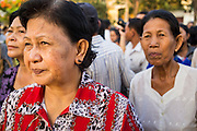 """30 JANUARY 2013 - PHNOM PENH, CAMBODIA:   Cambodians stop in front of the National Museum in Phnom Penh to look at the cremation site for late Cambodian King Norodom Sihanouk. Sihanouk (31 October 1922- 15 October 2012) was the King of Cambodia from 1941 to 1955 and again from 1993 to 2004. He was the effective ruler of Cambodia from 1953 to 1970. After his second abdication in 2004, he was given the honorific of """"The King-Father of Cambodia."""" Sihanouk held so many positions since 1941 that the Guinness Book of World Records identifies him as the politician who has served the world's greatest variety of political offices. These included two terms as king, two as sovereign prince, one as president, two as prime minister, as well as numerous positions as leader of various governments-in-exile. He served as puppet head of state for the Khmer Rouge government in 1975-1976. Most of these positions were only honorific, including the last position as constitutional king of Cambodia. Sihanouk's actual period of effective rule over Cambodia was from 9 November 1953, when Cambodia gained its independence from France, until 18 March 1970, when General Lon Nol and the National Assembly deposed him. Upon his final abdication, the Cambodian throne council appointed Norodom Sihamoni, one of Sihanouk's sons, as the new king. Sihanouk died in Beijing, China, where he was receiving medical care, on Oct. 15, 2012. His cremation is scheduled to take place on Feb. 4, 2013. Over a million people are expected to attend the service.        PHOTO BY JACK KURTZ"""