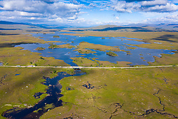 Aerial view of Loch Ba and A82 road on Rannoch Moor in summer, Scotland, UK