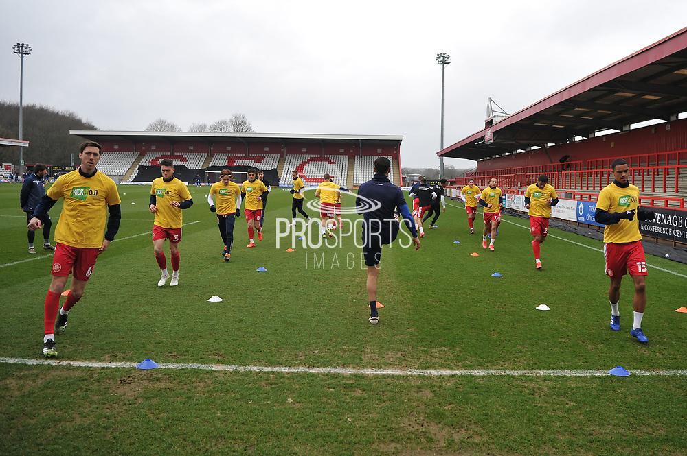 Stevenage defender Luke Prosser (6)   Stevenage defender Terence Vancooten (15) and team mates warming up during the EFL Sky Bet League 2 match between Stevenage and Carlisle United at the Lamex Stadium, Stevenage, England on 20 March 2021.
