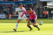 Luke Freeman (7) of Queens Park Rangers is challenged by Connor Roberts (23) of Swansea City during the EFL Sky Bet Championship match between Swansea City and Queens Park Rangers at the Liberty Stadium, Swansea, Wales on 29 September 2018.