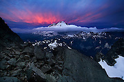 Sunset over Mount Baker viewed from below the summit of Mount Shuksan, North Cascades National Park, Washington.