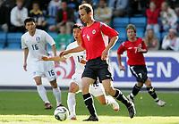 Fotball / Football<br /> Privatlandskamp / Friendly match<br /> Norge v Sør-Korea 0-0<br /> Norway v Korea Republic 0-0<br /> 01.06.2006<br /> Foto: Morten Olsen, Digitalsport<br /> <br /> Jon Inge Høiland<br /> Young-Pyo Lee