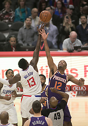 December 20, 2017 - Los Angeles, California, U.S - Jamil Wilson #13 of the Los Angeles Clippers and T.J. Warren #12 of the Phoenix Suns jump shot during their NBA game on Wednesday December 20, 2017 at the Staples Center in Los Angeles, California. Clippers vs Suns. (Credit Image: © Prensa Internacional via ZUMA Wire)