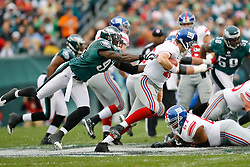 Philadelphia Eagles defensive end Chris Clemons #91 gets his hands on the Giants Quarterback during the NFL game between the New York Giants and the Philadelphia Eagles on November 1st 2009. The Eagles won 40 to 17 at Lincoln Financial Field in Philadelphia, Pennsylvania. (Photo By Brian Garfinkel)