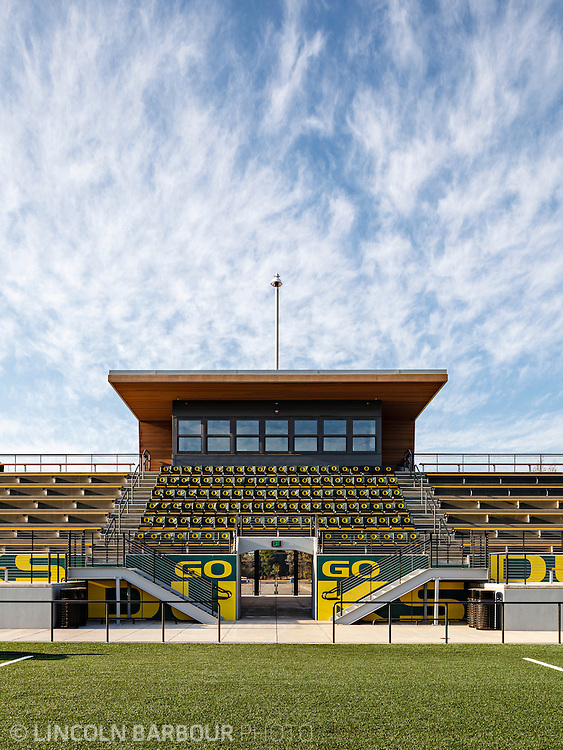 Architectural photo of University of Oregon's Women's Soccer & Lacrosse Stadium. Designed by DLR Group. A more detailed, graphic view of the announcers box portion of the bleachers. Blue skies overhead.