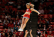A Utah Utes cheerleader performs during an NCAA college basketball game against UNLV in Salt Lake City, Saturday, March. 5, 2011. (AP Photo/Colin E Braley)