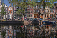 Amsterdam, the Netherlands -- July 30, 2019. <br /> A wide angle shot of houses taken across the Herengracht canal in Amsterdam.