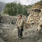 Poymona is 11 years old. He is just returning from herding the village's 100 sheep or so. While at it, he collected wood for his home. <br /> The traditional life of the Wakhi people, in the Wakhan corridor, amongst the Pamir mountains.