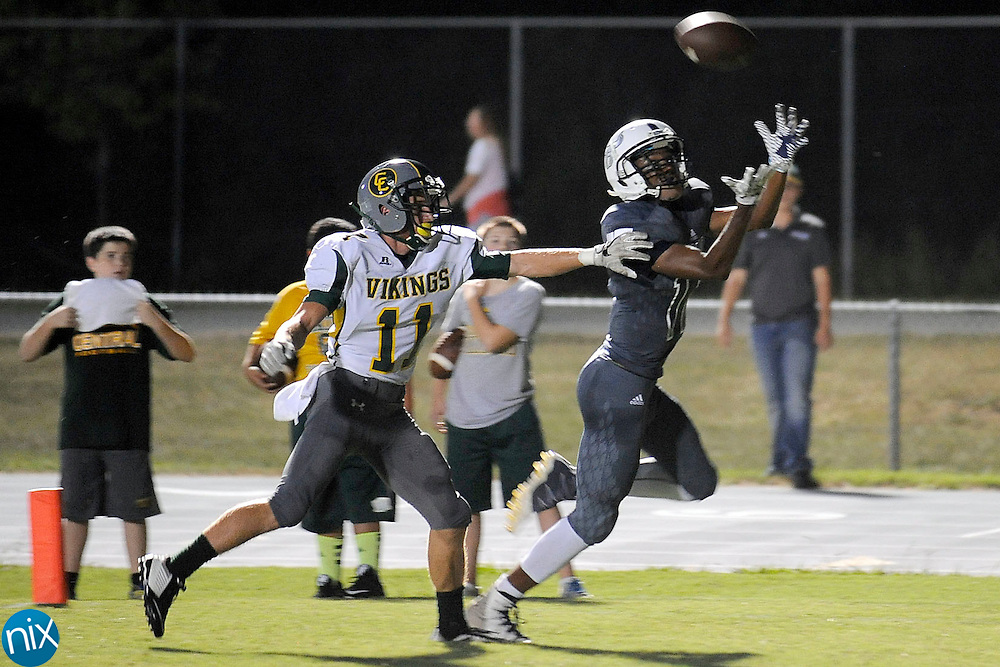 Despite the best efforts of Vikings safety Tristen Ryen (11, left), Ragin' Bulls wide receiver Jarett Garner (11) catches this pass for the first touchdown during the Central Cabarrus Vikings at Hickory Ridge Ragin' Bulls high school football game on Friday  night.
