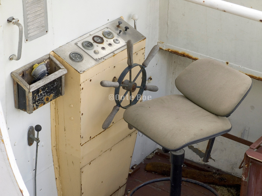 the wheel of an old recreational boat